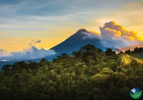 arenal photo with clouds and trees